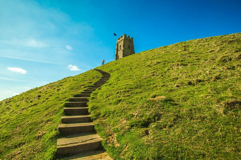 path to glastonbury tor over green hill