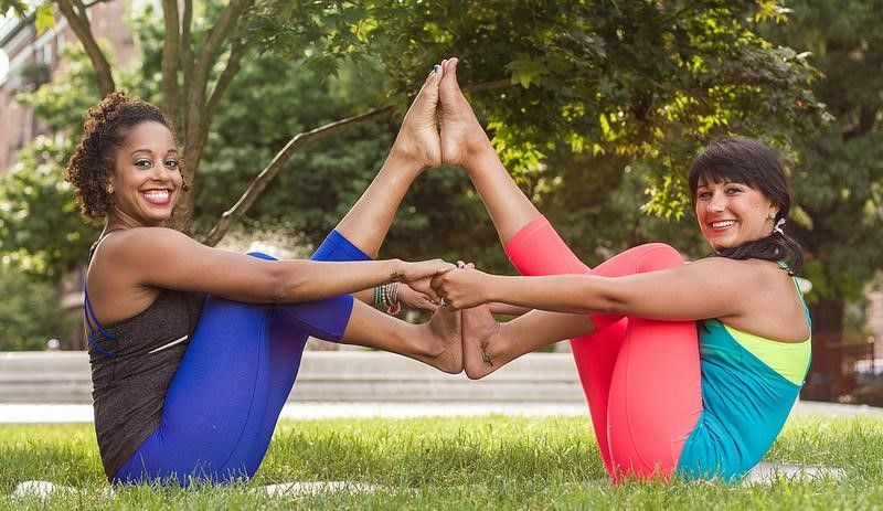 friends having yoga in the park