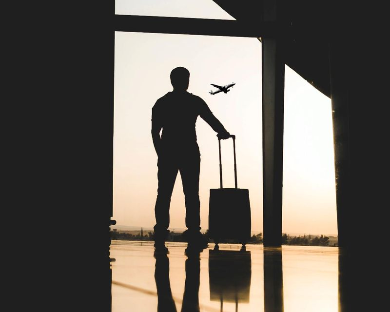 man on the airport with suitcase