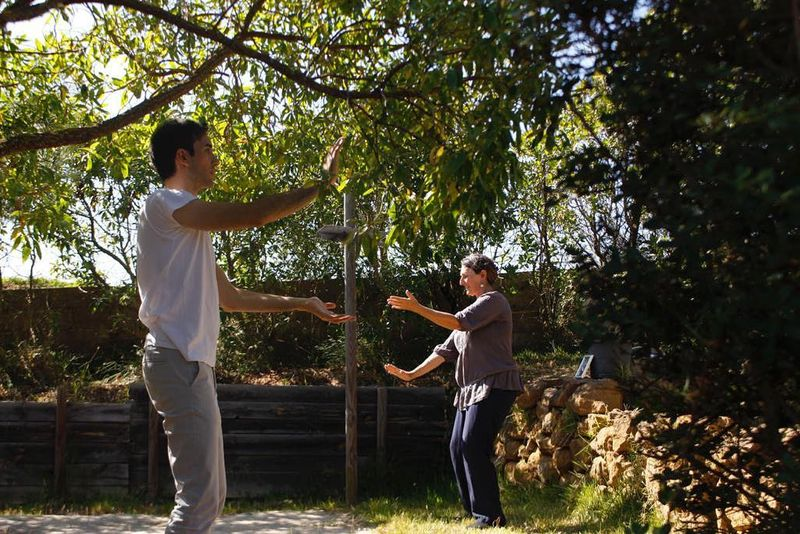 practicing qigong with a teacher