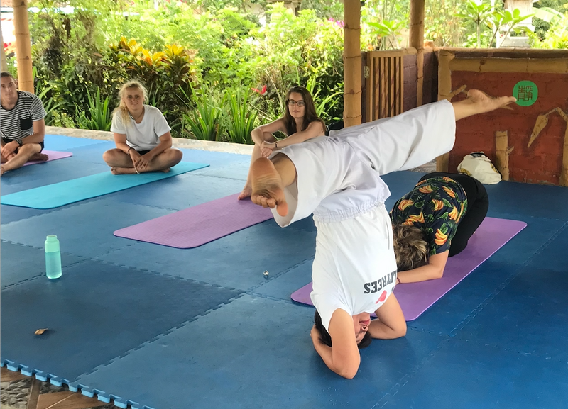a yoga instructor doing a headstand
