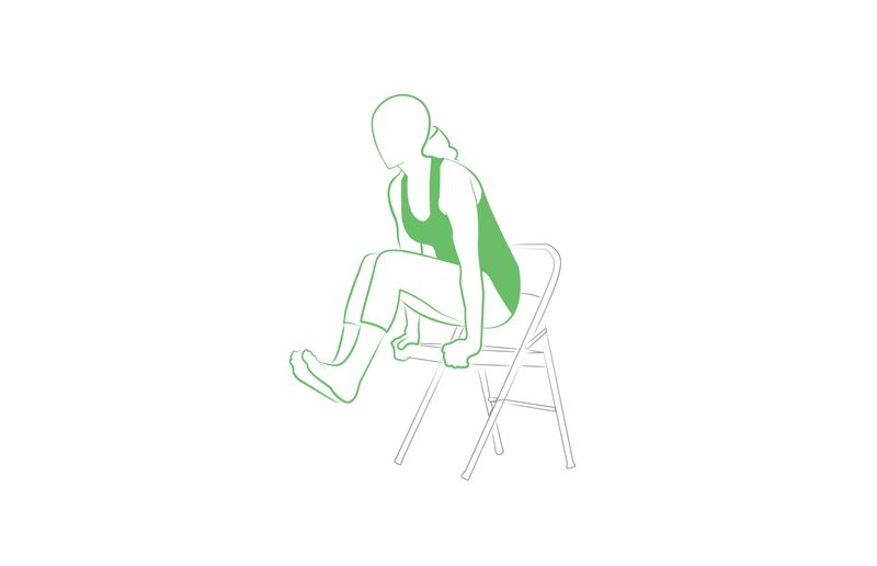 yoga scale pose on a chair feet in the air