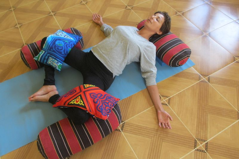 enjoying a restorative yoga class
