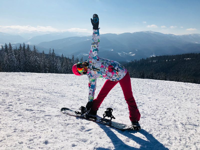 anna doing yoga and snowboarding