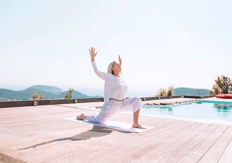 yoga by the pool in Greece