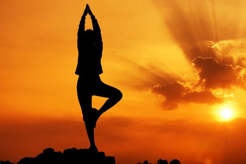 sun salutation silhouette in sunrise
