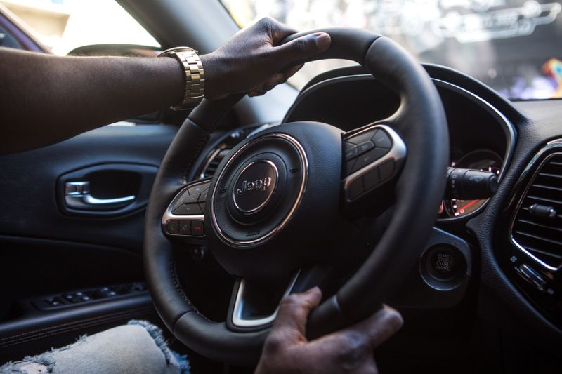 man driving hands on the wheel