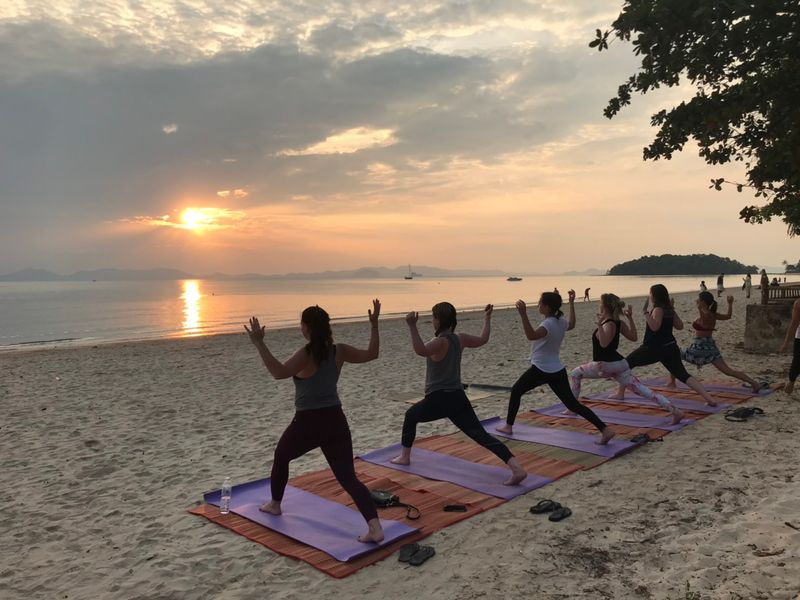 sun salutation at the beach