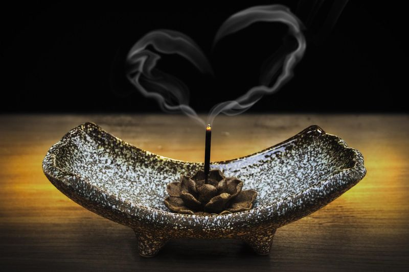 incense holder on black background