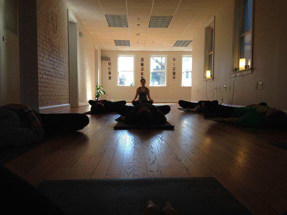 women meditating in dark room