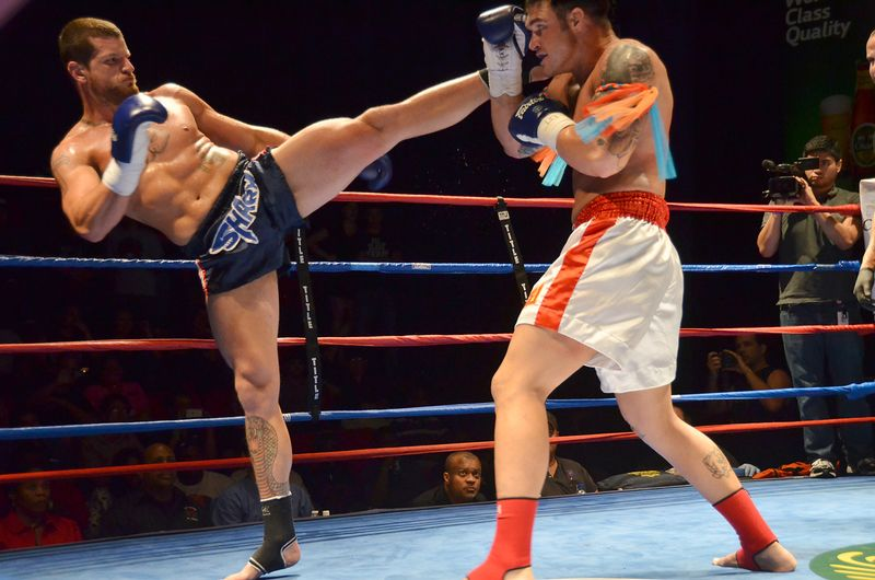 muay thai fighters with a high kick