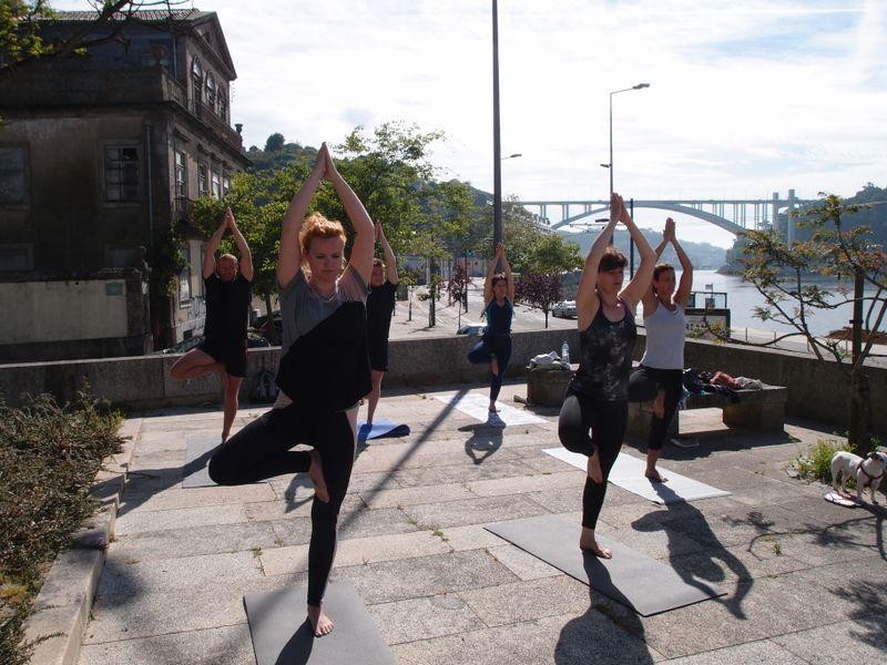 yoga on the river shore in porto