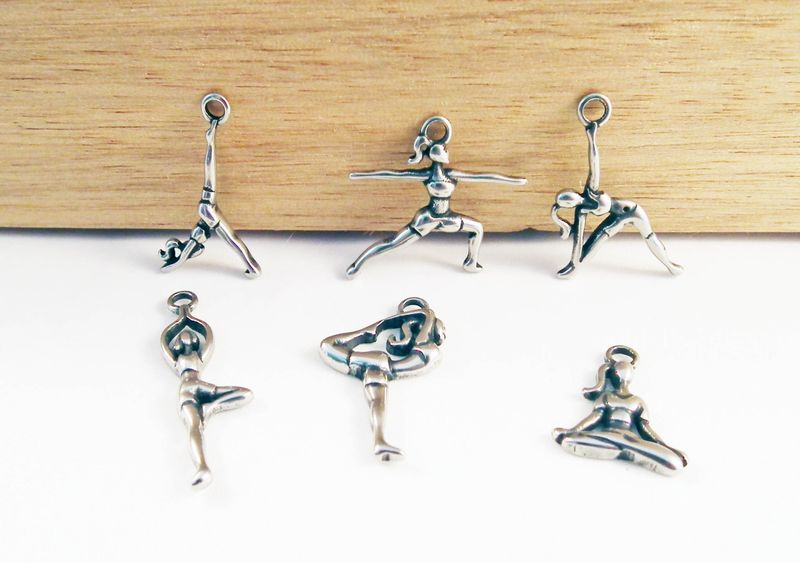 yoga pose pendants made of silver