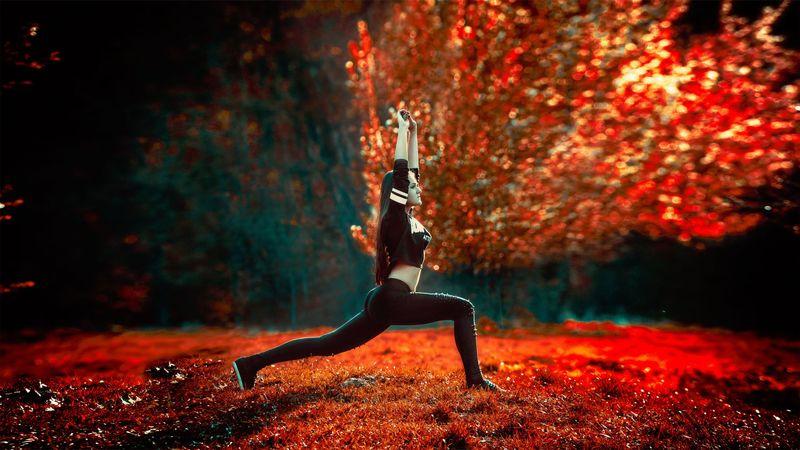 woman doing yoga in beautiful autumn scenery