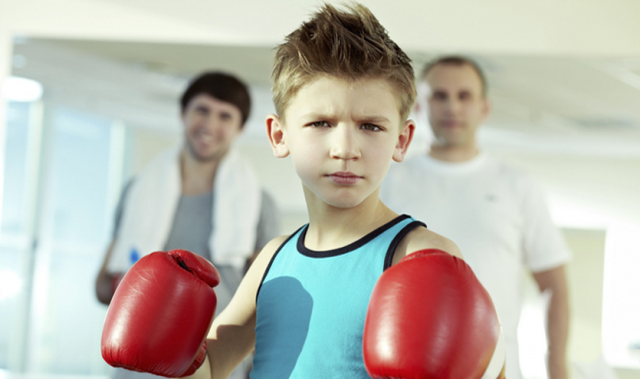 mma kid with boxing gloves
