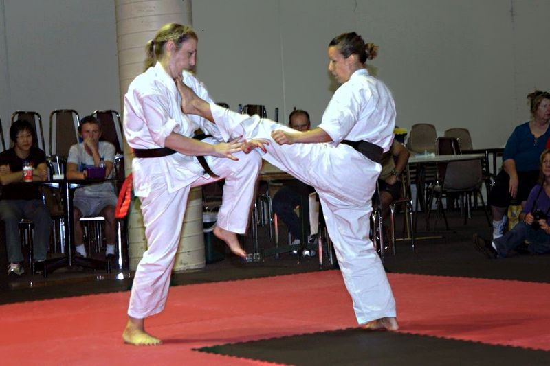 two women fighting a judo match