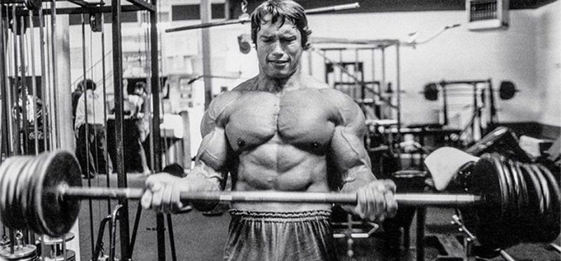 arnold working out muscles historical photo