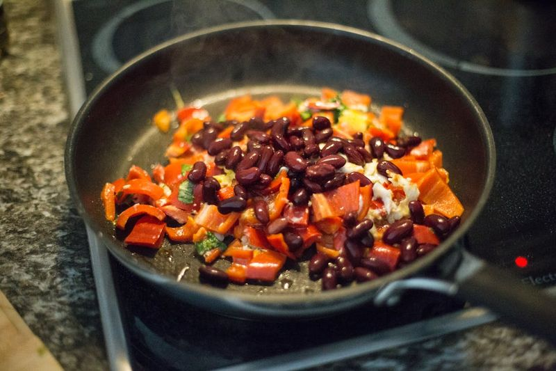 beans and bell peppers in a pan for breakfast