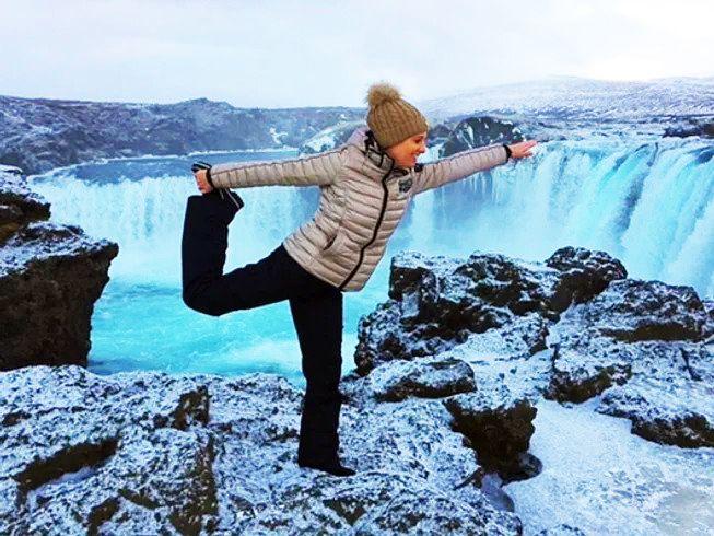 yoga over waterfall in winter