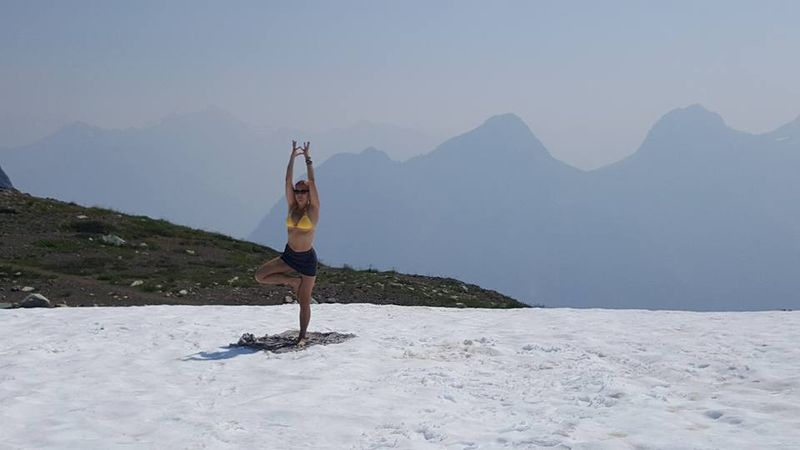 doing yoga on a snow covered field