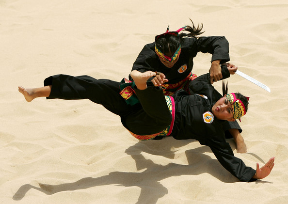 karate fighters on the beach