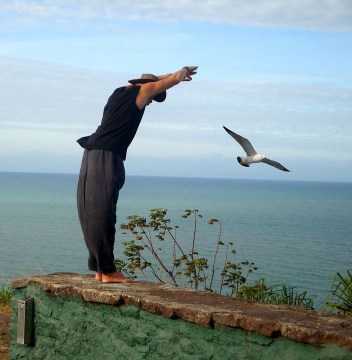 man-taking-flight-yoga-pose-outdoor