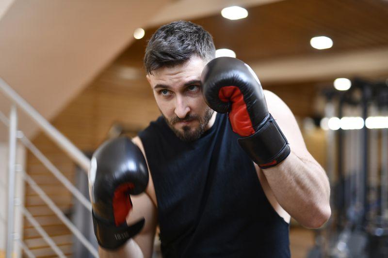 man practicing boxing at home