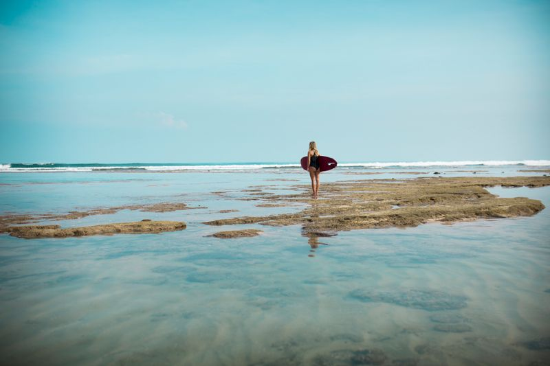 getting ready to surf in indonesia