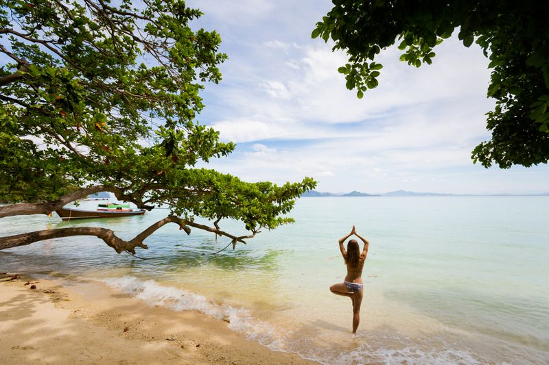 yoga on the beach in thailand