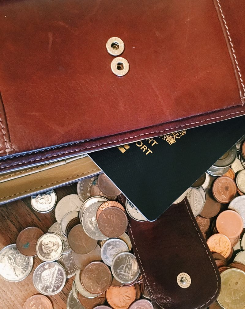 wallet with coins and passport