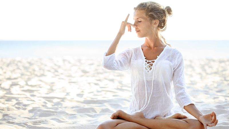 woman practicing pranayama