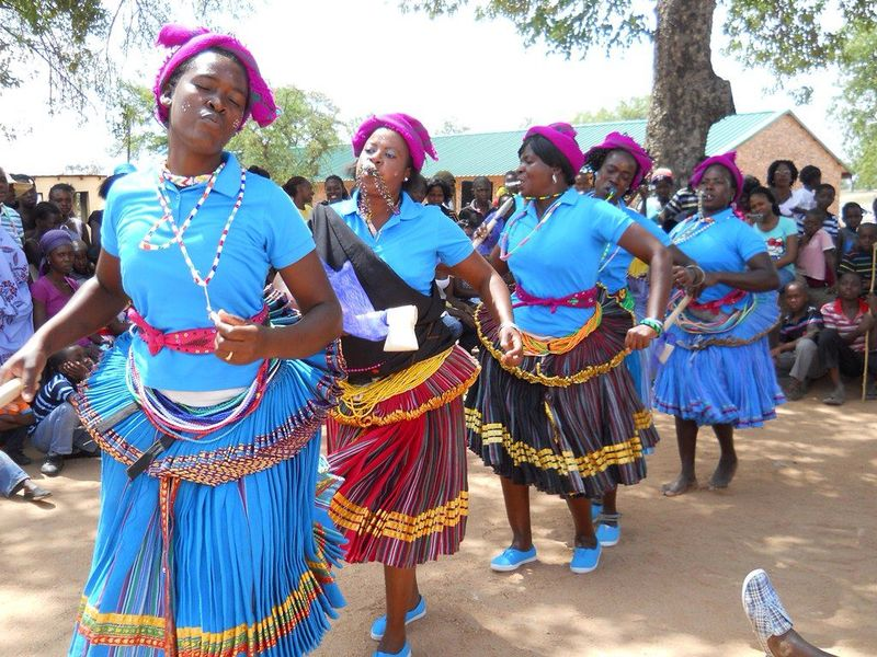 women dancing in traditional clothes