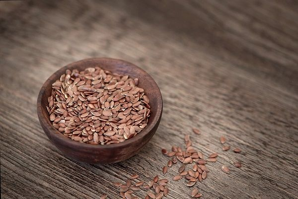 flax seeds in wooden bowl