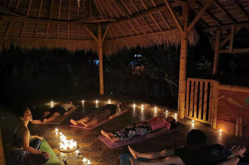 a restorative yoga class at night