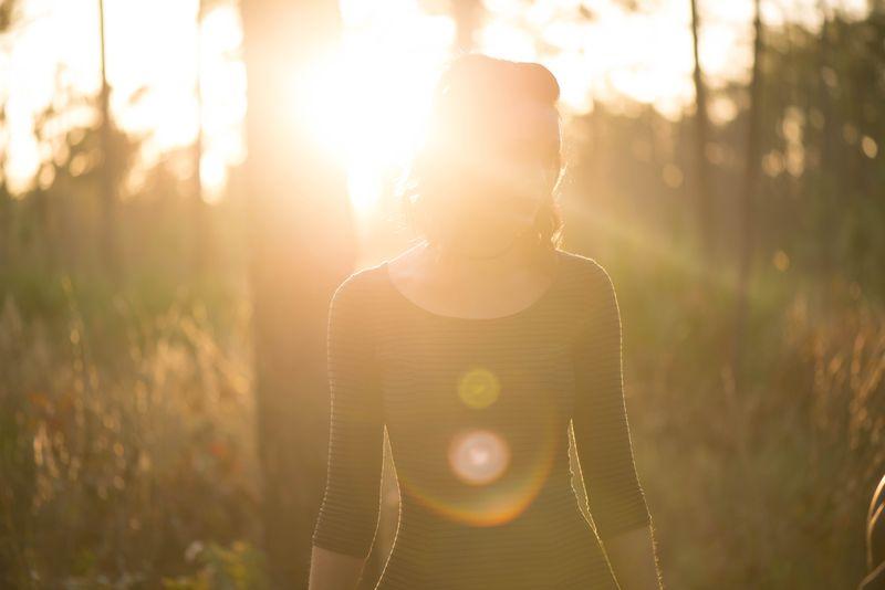woman in the sun beams