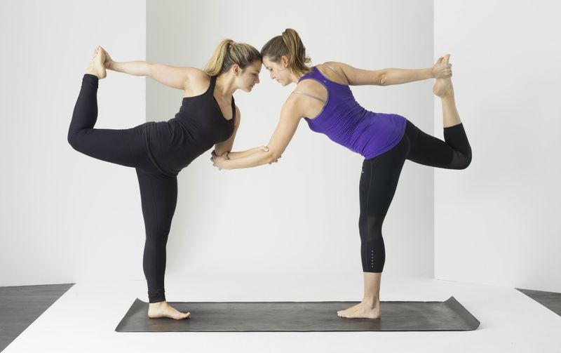 Two people doing yoga