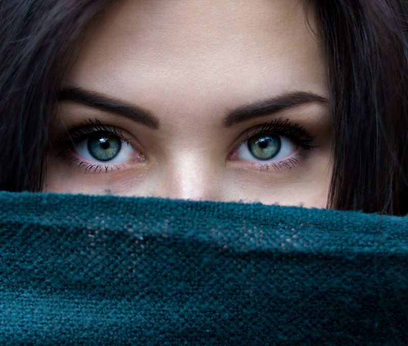 woman's face covered with scarf