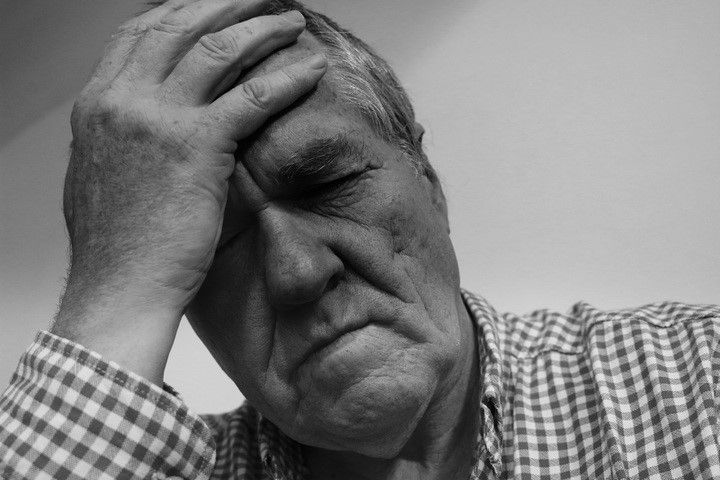 old man feeling pain black and white photo