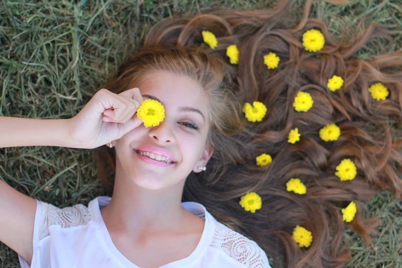beautiful girl smile yellow flowers in her hair