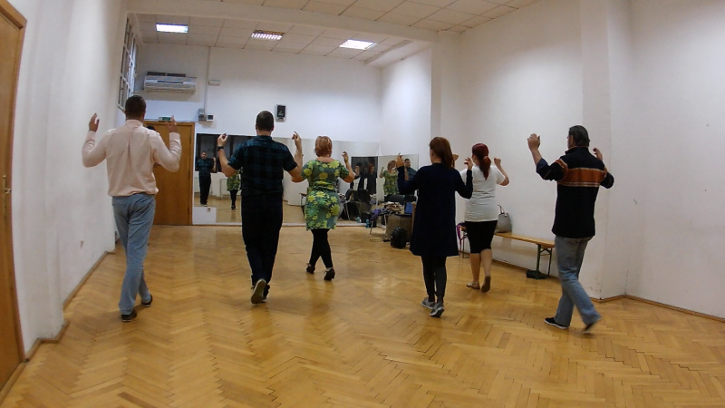 group of tango dancers practicing forward walk