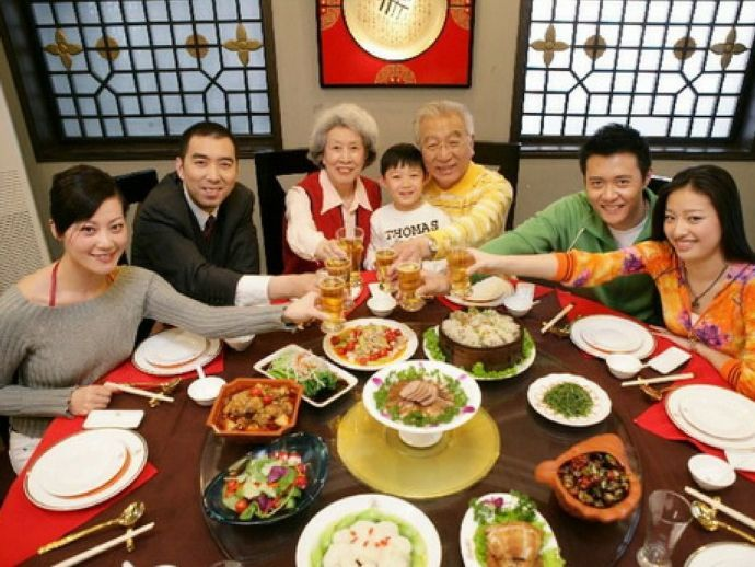 Chinese family eating together