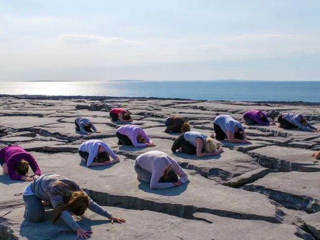yoga on cliff