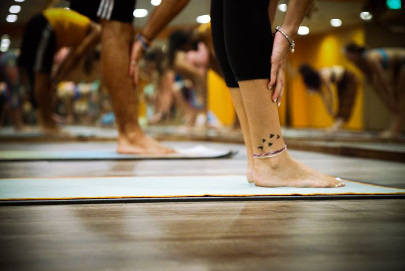 legs and feet of yoga class participants