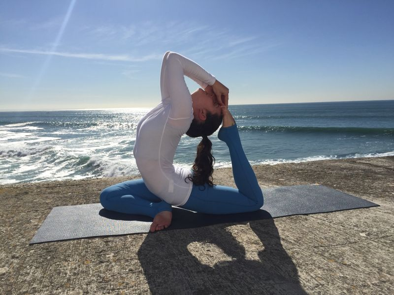 sun salutation yoga practice on the beach in portugal