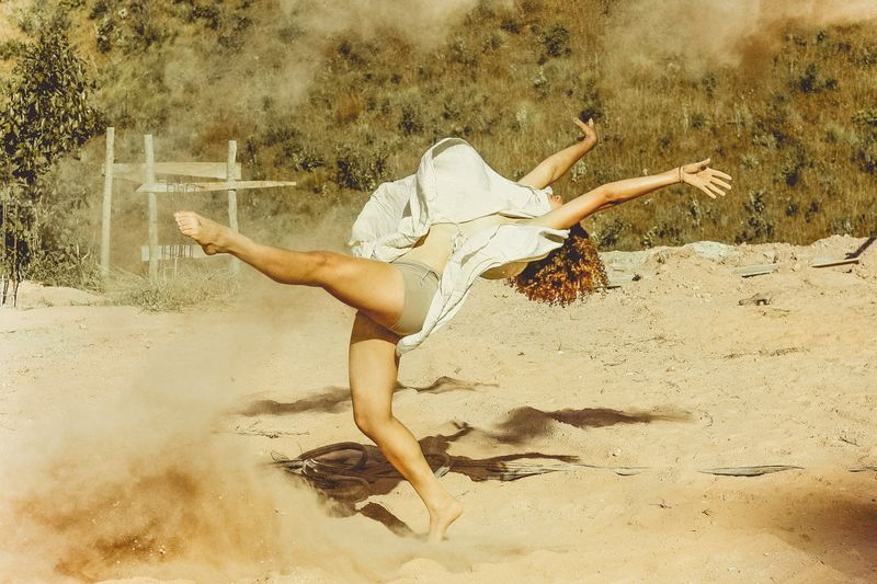 woman dancing in the sand