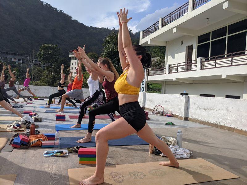 practising vinyasa yoga outdoor