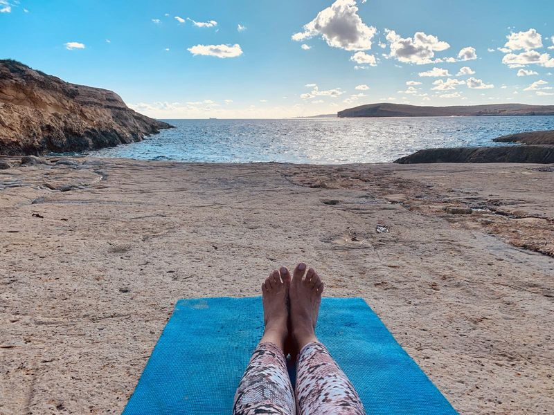 yoga on the beach, with a view of the water