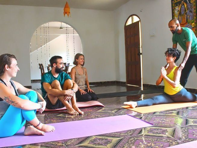 yoga teacher guiding class