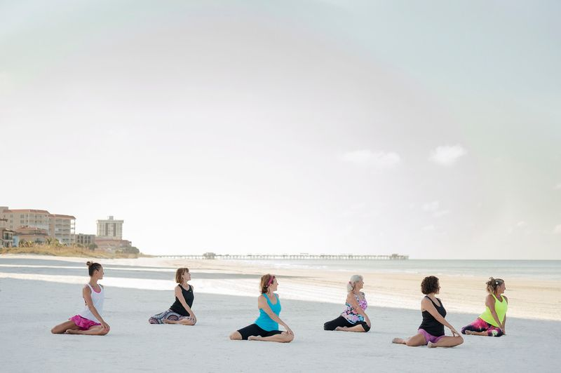 yoga group on the beach