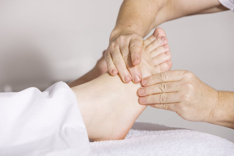 massage therapy post accident PT massaging feet